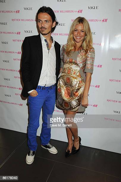 Matthew Williamson and Sienna Miller attend the launch party for Matthew Williamson's new collection for HM at HM Regent Street on April 22 2009 in...