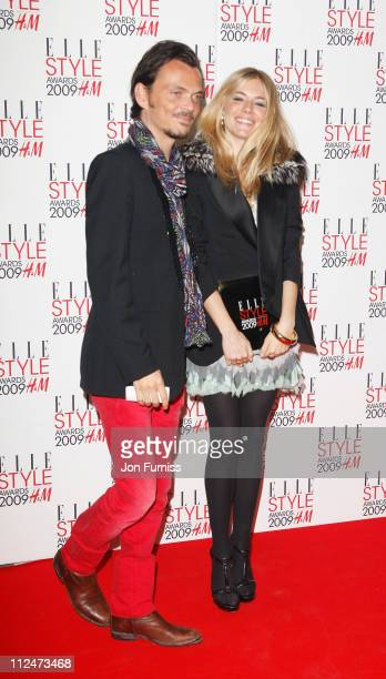 Matthew Williamson and Sienna Miller poses in the Press Room with her award for Style Icon at the ELLE Style Awards 2009 held at Big Sky London...