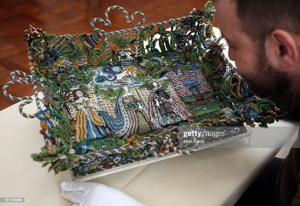 Matthew Winterbottom, Curator of Decorative Art, holds a rare seventeenth-century beadwork basket that the Holburne Museum has launched a appeal to acquire for its permanent collection at the Holburne Museum on April 23, 2013 in Bath, England. Made in England around 1665, the basket - which depicts Charles II who had recently been restored to the throne, and Catherine of Braganza next to a castle within a leafy landscape - is a rare survivor and is made from thousands of brightly coloured glass beads of varying sizes, threaded onto fine wires and attached to the mesh-like basket frame. To secure it for its collection, the Holburne needs the public to make donations totaling 6,000 GDP towards the 78,000 GDP cost of the basket, the majority of which is being sought through grants. The Museum has until July to raise 6,000 GDP.