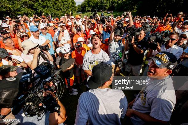 Matthew Wolff of Oklahoma State screams while surrounded by the press fans and his team after winning the Division I Men's Golf Team Match Play...