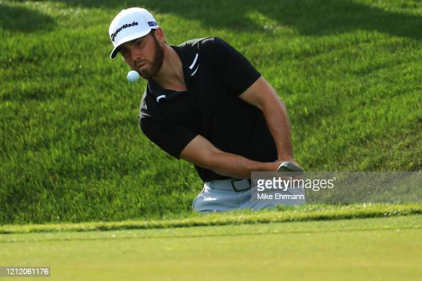 Matthew Wolff of the United States chips to the 15th green during the first round of The PLAYERS Championship on The Stadium Course at TPC Sawgrass...