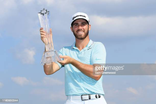Matthew Wolff of the United States poses for a photo with the trophy after winning the 3M Open at TPC Twin Cities on July 07 2019 in Blaine Minnesota