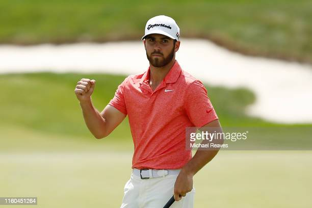 Matthew Wolff of the United States reacts after making a birdie putt on the 18th green during the third round of the 3M Open at TPC Twin Cities on...
