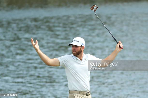 Matthew Wolff of the United States reacts on the 17th green during a practice round prior to The PLAYERS Championship on The Stadium Course at TPC...