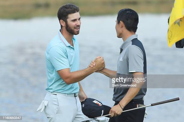 Matthew Wolff of the United States shakes hands with Collin Morikawa of the United States on the 18th green after the final round of the 3M Open at...