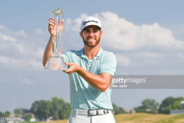 Matthew Wolff poses with the 3M Open trophy on the eighteenth green after the final round of the 3M Open at TPC Twin Cities on July 7 2019 in Blaine...