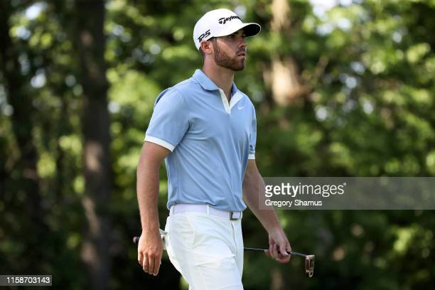 Matthew Wolff walks across the 11th hole during round one of the Rocket Mortgage Classic at the Detroit Country Club on June 27 2019 in Detroit...