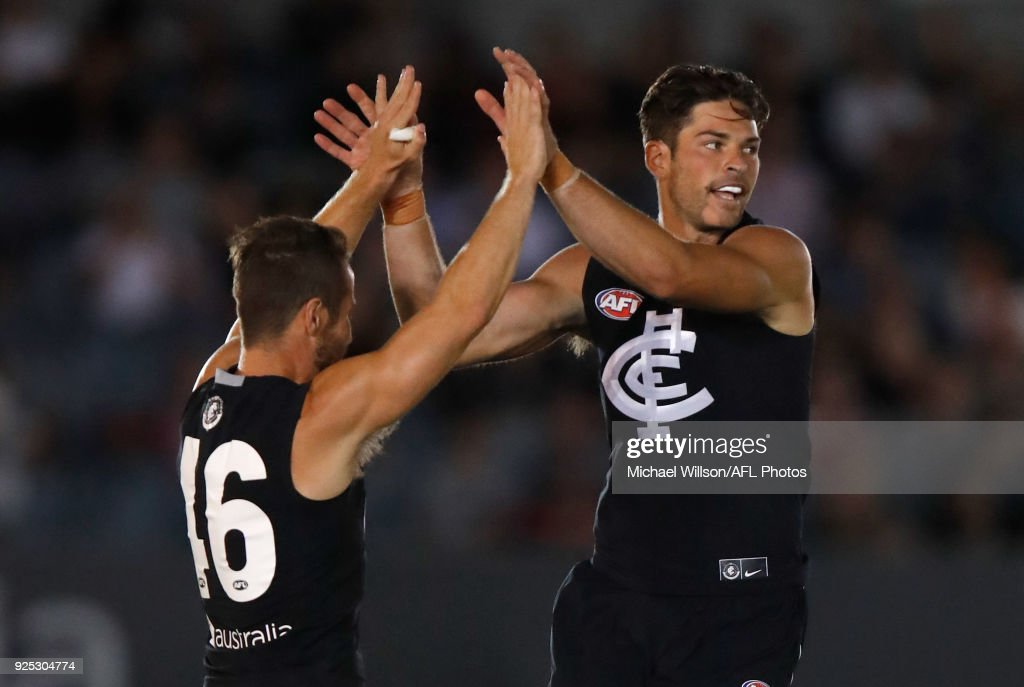 Matthew Wright (left) and Levi Casboult of the Blues celebrate during the AFL 2018 JLT Community Series match between the Carlton Blues and the St Kilda Saints at Ikon Park on February 28, 2018 in Melbourne, Australia.