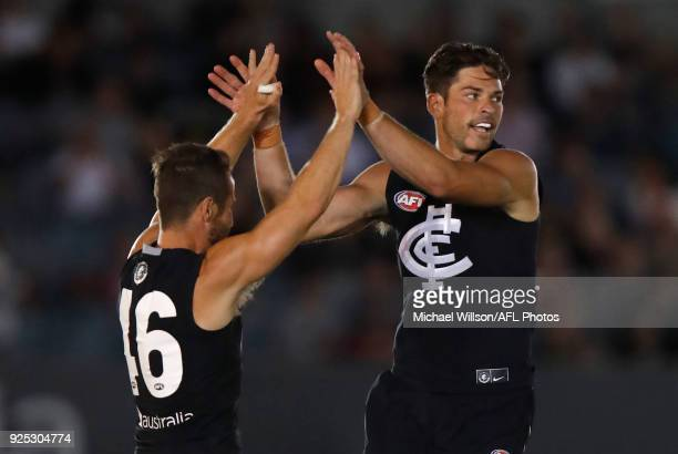 Matthew Wright and Levi Casboult of the Blues celebrate during the AFL 2018 JLT Community Series match between the Carlton Blues and the St Kilda...