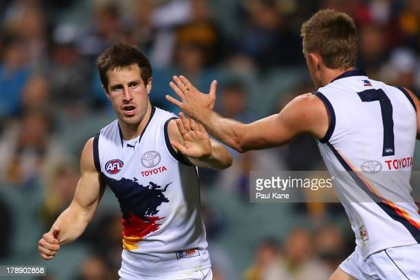 Matthew Wright and Nathan Van Berlo of the Crows celebrate a goal during the round 23 AFL match between the West Coast Eagles and the Adelaide Crows...