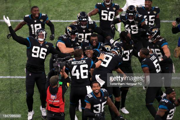 Matthew Wright of Jacksonville Jaguars is mobbed by team mates in celebration after kicking a field goal to win during the NFL London 2021 match...