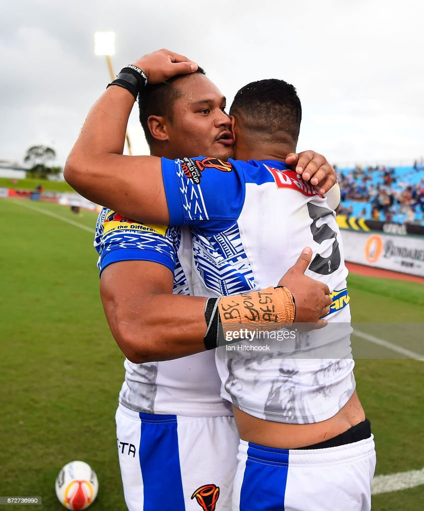 Matthew Wright of Samoa celebrates after scoring a try with Joseph Leilua during the 2017 Rugby League World Cup match between Samoa and Scotland at Barlow Park on November 11, 2017 in Cairns, Australia.