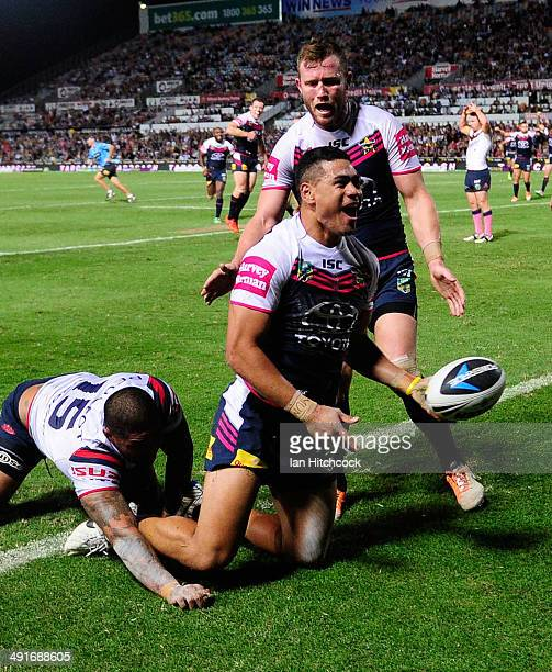 Matthew Wright of the Cowboys celebrates after scoring a try during the round 10 NRL match between the North Queensland Cowboys and the Sydney...