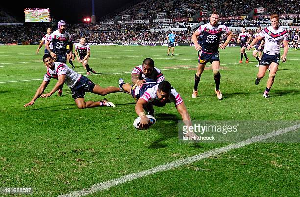 Matthew Wright of the Cowboys scores a try during the round 10 NRL match between the North Queensland Cowboys and the Sydney Roosters at 1300SMILES...