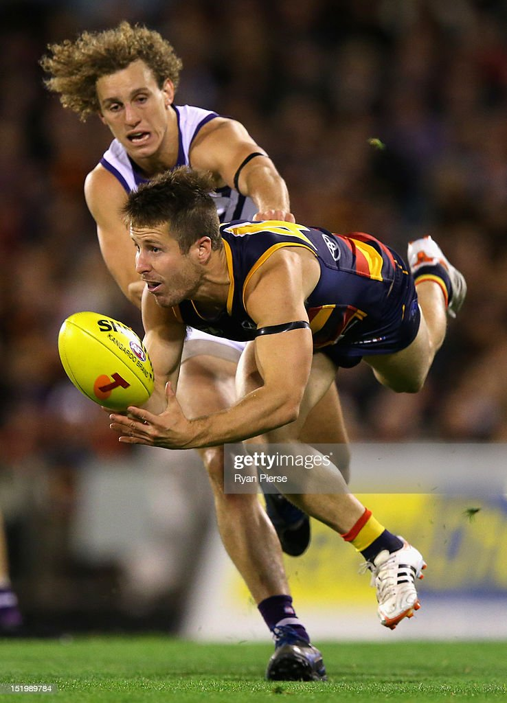 Matthew Wright of the Crows gets a handball away despite pressure from Chris Mayne of the Dockers during the AFL Second Semi Final match between the Adelaide Crows and the Fremantle Dockers at AAMI Stadium on September 14, 2012 in Adelaide, Australia.
