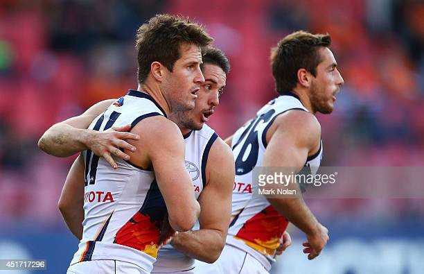 Matthew Wright of the Crows is congratulated after kicking a goal during the round 16 AFL match between the Greater Western Giants and the Adelaide...