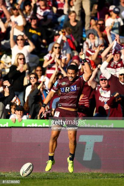 Matthew Wright of the Sea Eagles celebrates scoring a try during the round 19 NRL match between the Manly Sea Eagles and the Wests Tigers at...