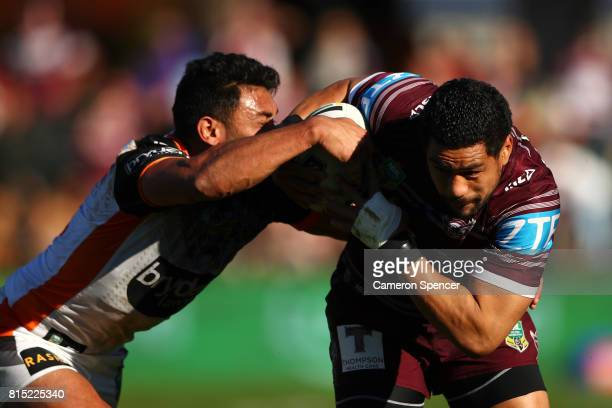 Matthew Wright of the Sea Eagles is tackled during the round 19 NRL match between the Manly Sea Eagles and the Wests Tigers at Lottoland on July 16...