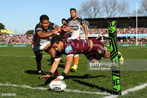 Matthew Wright of the Sea Eagles scores a try during the round 19 NRL match between the Manly Sea Eagles and the Wests Tigers at Lottoland on July 16...