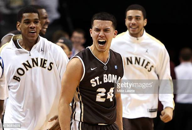 Matthew Wright of the St Bonaventure Bonnies celebrates after a game winning basket by Jordan Gathers against the Saint Louis Billikens during the...