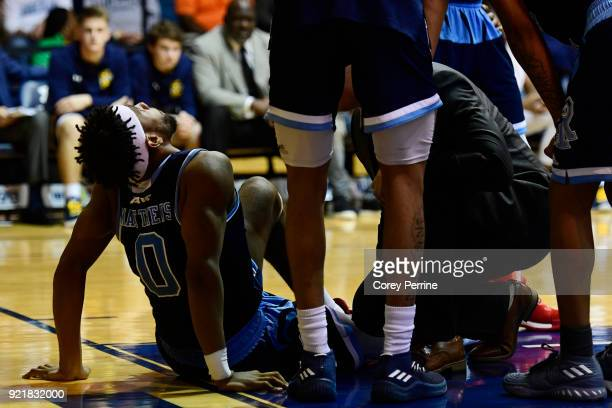C Matthews of the Rhode Island Rams lies on the floow with an injury during overtime at Tom Gola Arena on February 20 2018 in Philadelphia...