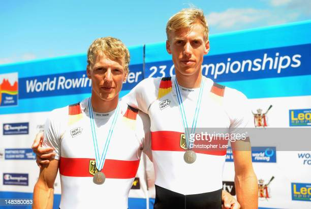Matthias Arnold and Julius Peschel of Germany with their Silver medals for the Lightweight Men's Double Sculls Final during Day 5 of the 2012 FISA...
