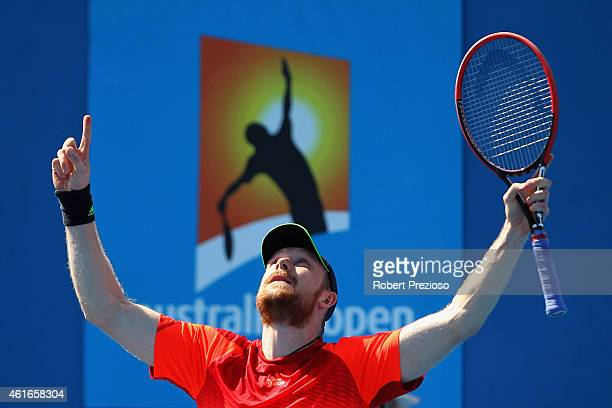Matthias Bachinger of Germany celebrates winning in his qualifying match against Andreas Beck of Germany for 2015 Australian Open at Melbourne Park...