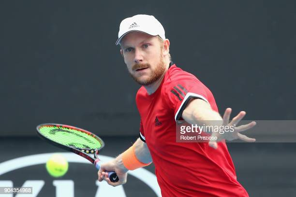 Matthias Bachinger of Germany competes in his second round match against James Duckworth of Australia during 2018 Australian Open Qualifying at...