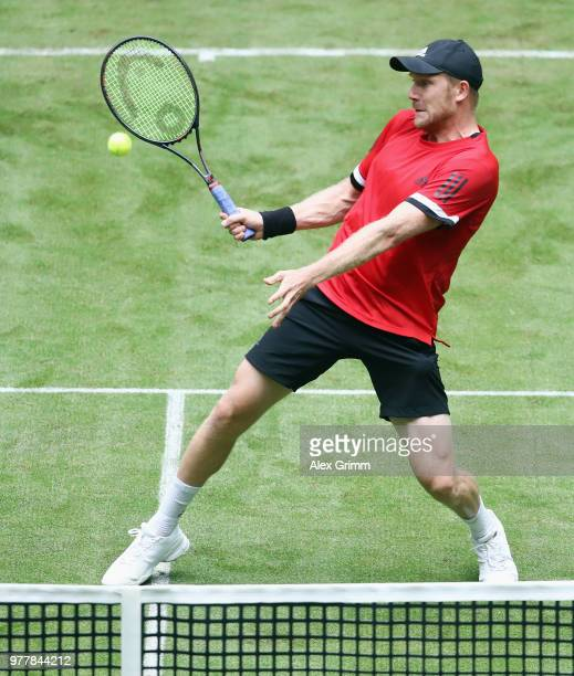 Matthias Bachinger of Germany plays a forehand volley to Kei Nishikori of Japan during their first round match during day 1 of the Gerry Weber Open...