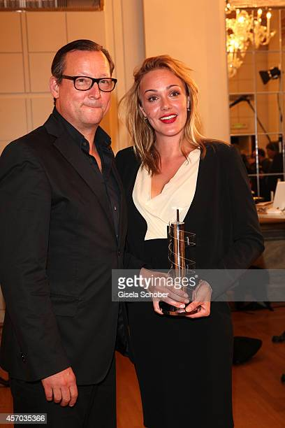 Matthias Brandt and Alwara Hoefels with award attend the Hessian Film And Cinema Award 2014 on October 10 2014 at Alte Oper in Frankfurt am Main...