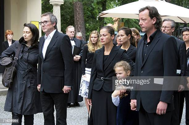 Matthias Brandt Lars Brandt and Peter Brandt and their wives attend the funeral of Rut Brandt at the Waldfriedhof Church on August 11 2006 in Berlin...