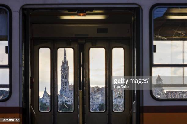 matthias church framed by tram windows - train interior stock photos and pictures