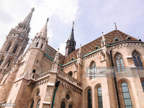 matthias church is a roman catholic church located in budapest, hungary, in front of the fisherman's bastion at the heart of buda's castle district. - royal palace budapest stock pictures, royalty-free photos & images