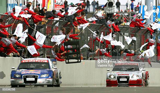 Matthias Ekstrom of Sweden and Tom Kristensen of Denmark and Audi cross the finish line during the German Touring Car Championship DTM 2005 at the...