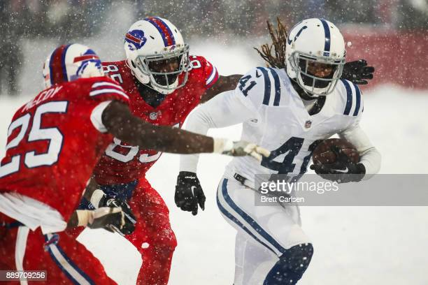 Matthias Farley of the Indianapolis Colts intercepts the ball as Charles Clay of the Buffalo Bills and LeSean McCoy of the Buffalo Bills attempt to...
