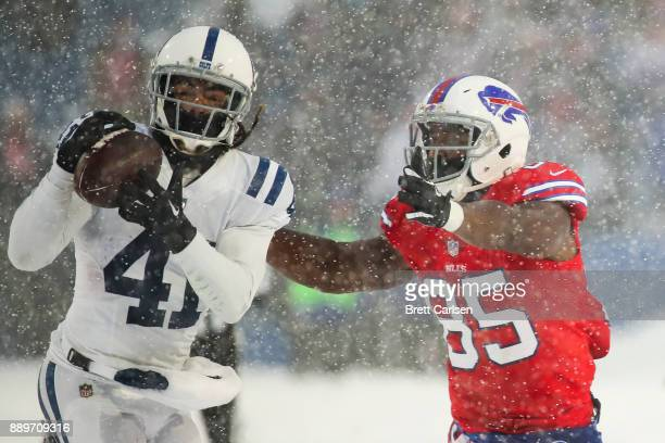 Matthias Farley of the Indianapolis Colts intercepts the ball as Charles Clay of the Buffalo Bills attempts to tackle him during overtime on December...