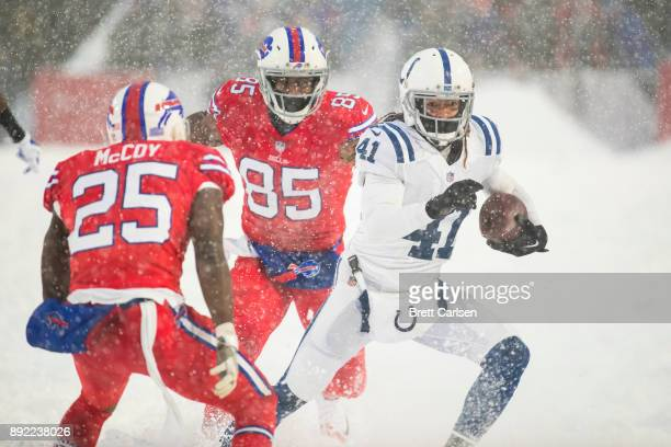 Matthias Farley of the Indianapolis Colts runs with an intercepted pass intended for Charles Clay of the Buffalo Bills during the fourth quarter at...