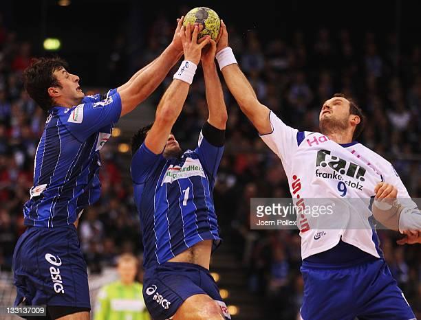 Matthias Flohr of Hamburg is challenged by Jens Tiedtke of Grosswallstadt during the Toyota Handball Bundesliga match between HSV Hamburg and TV...