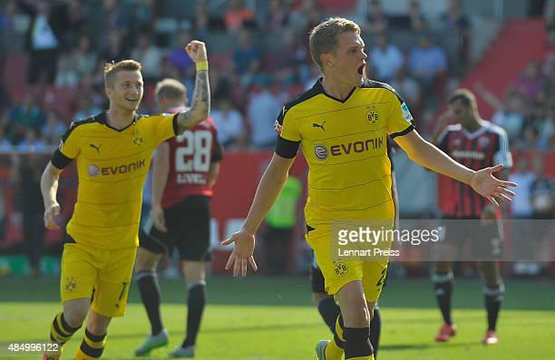 Matthias Ginter and Marco Reus of Borussia Dortmund celebrate scoring the opening goal during the Bundesliga match between FC Ingolstadt and Borussia...