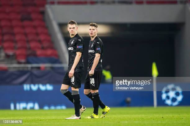 Matthias Ginter and Nico Elvedi of Borussia Moenchengladbach are seen after the UEFA Champions League Round Of 16 Leg One match between Borussia...