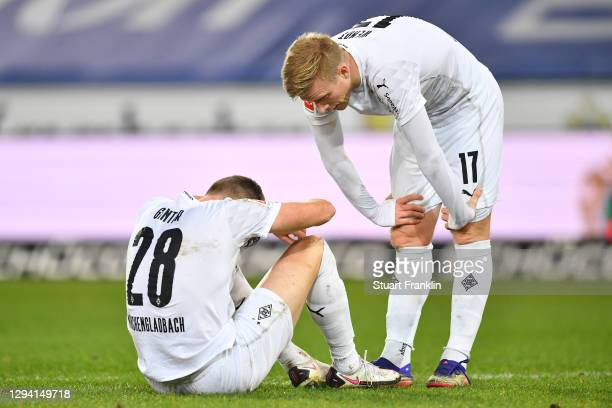 Matthias Ginter and Oscar Wendt of Moenchengladbach react during the Bundesliga match between DSC Arminia Bielefeld and Borussia Moenchengladbach at...