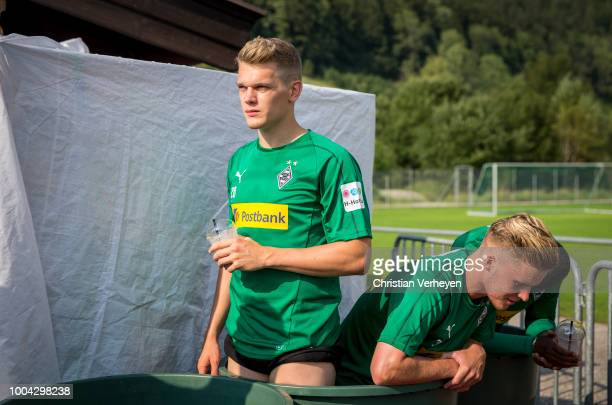 Matthias Ginter Nico Elvedi and Mamadou Doucoure cool down in a ice box after a Training Session at Borussia Moenchengladbach Training Camp at...