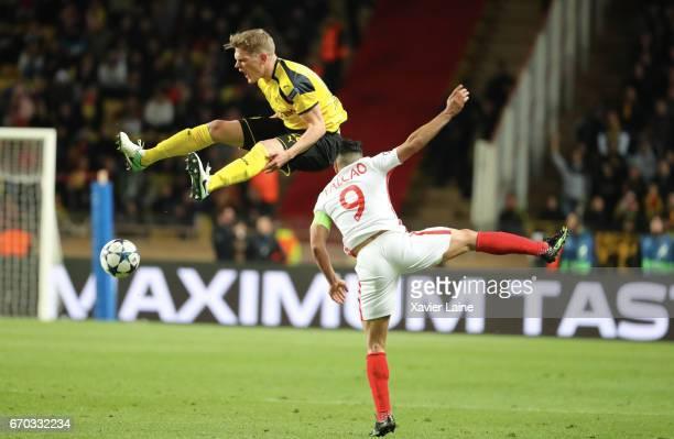 Matthias Ginter of Borrussia Dortmund jump over Radamel Falcao of AS Monaco during the UEFA Champions League Quarter Final second leg between AS...