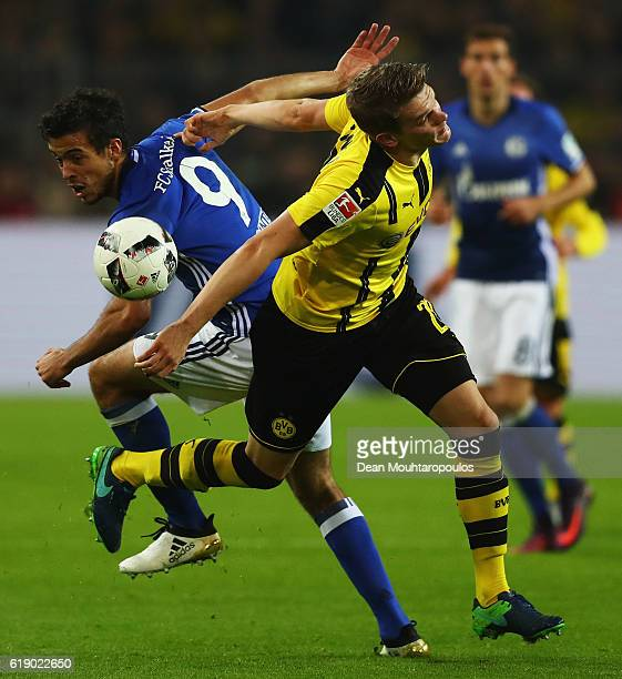 Matthias Ginter of Borussia Dortmund battles for the ball with Franco Di Santo of Schalke during the Bundesliga match between Borussia Dortmund and...