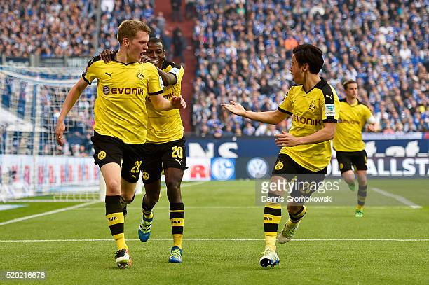 Matthias Ginter of Borussia Dortmund celebrates with his teammates Shinji Kagawa and Adrian Ramos after scoring his team's second goal during the...