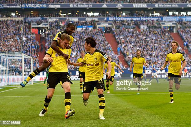Matthias Ginter of Borussia Dortmund celebrates with his teammates Shinji Kagawa and Adrian Ramos after scoring his team's second goal during the...
