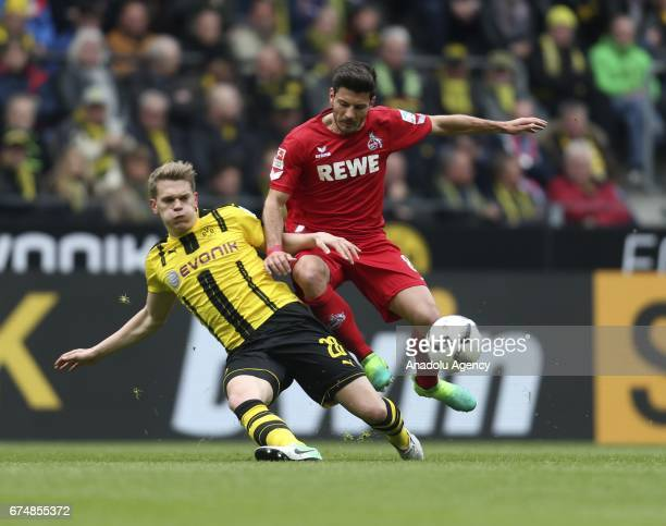 Matthias Ginter of Borussia Dortmund challenges with Milos Jojic of 1FC Cologne during the Bundesliga soccer match between Borussia Dortmund and 1FC...