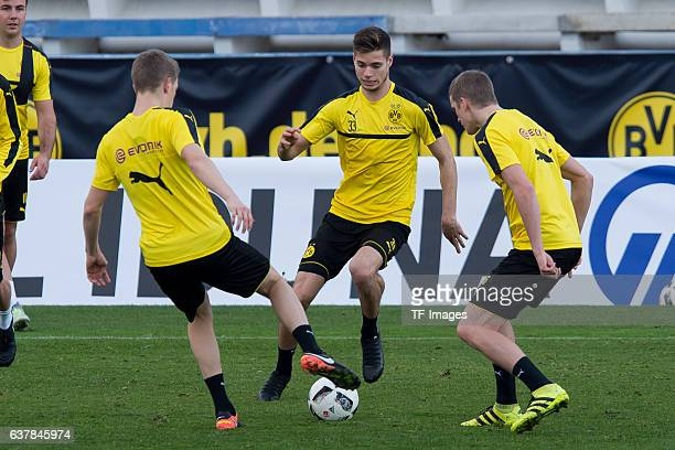 Matthias Ginter of Borussia Dortmund Julian Weigl of Borussia Dortmund and Sven Bender of Borussia Dortmund battle for the ball during the second day...