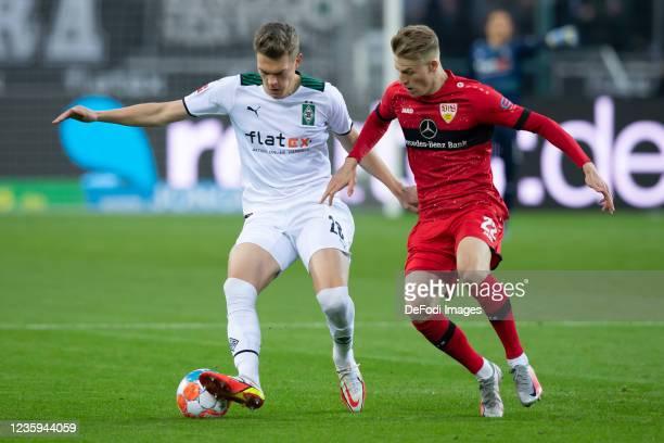 Matthias Ginter of Borussia Moenchengladbach and Chris Fuehrich of VfB Stuttgart battle for the ball during the Bundesliga match between Borussia...