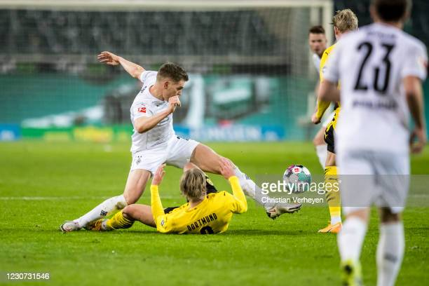Matthias Ginter of Borussia Moenchengladbach and Erling Haaland of Borussia Dortmund battle for the ball during the Bundesliga match between Borussia...